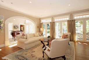 Traditional Living Room with Carpet, Transom window, Columns, Crown molding, six panel door, French doors, can lights