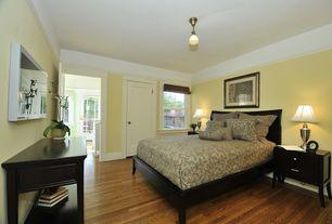 Modern Guest Bedroom with Laminate floors, flush light