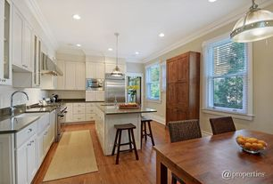 Traditional Kitchen with Soapstone, Kitchen island, Casement, built-in microwave, can lights, Flat panel cabinets, Wall Hood