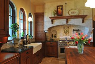 Country Kitchen with Kitchen island, Wood counters, Meta travertine tile - antique bronze cobbled, High ceiling, Raised panel
