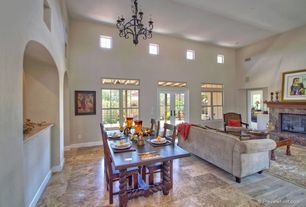 Mediterranean Great Room with French doors, travertine tile floors, Chandelier, High ceiling, stone fireplace, Transom window