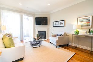 Modern Living Room with Crown molding, Hardwood floors, Cement fireplace, French doors