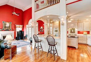 Traditional Great Room with Columns, Ceiling fan, can lights, Cathedral ceiling, Hardwood floors, Transom window, Loft