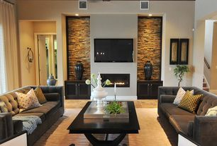 Contemporary Living Room with Ducalli Coffee Table, travertine tile floors, Ceiling fan, Crown molding, Atwood Sofa