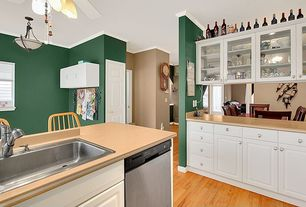 Traditional Kitchen with Kitchen island, Raised panel, Ceiling fan, drop-in sink, Standard height, dishwasher, Crown molding