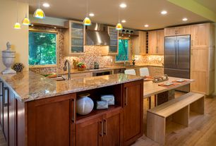Craftsman Kitchen with UltraCraft Decorative Art Glass Cabinets, Glass panel, Complex granite counters, Undermount sink
