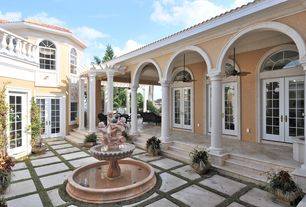 Mediterranean Patio with Arched window, exterior tile floors, exterior concrete tile floors, French doors, Deck Railing