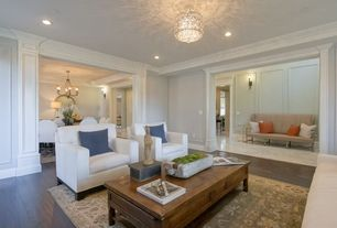 Traditional Living Room with can lights, Crown molding, Standard height, Chandelier, Hardwood floors