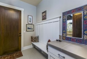 Eclectic Mud Room with Built-in bookshelf, Laminate floors, specialty door