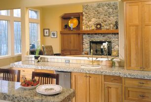 Country Kitchen with Ms international blanco tulum granite, Undermount sink, Transom window, Breakfast bar, Bar stools