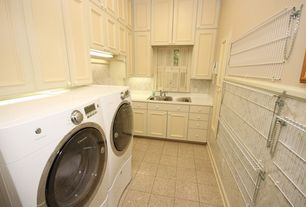 Traditional Laundry Room with simple granite tile floors, laundry sink, Built-in bookshelf, stone tile floors, flush light