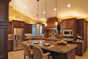 Traditional Kitchen with Casement, full backsplash, wall oven, can lights, dishwasher, Custom hood, Breakfast bar, L-shaped