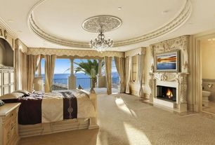 Traditional Master Bedroom with Chandelier, Crown molding, Cement fireplace, Carpet, Built-in bookshelf