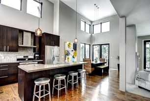 Contemporary Great Room with Paint 1, Mosaic tile backsplash, picture window, Hardwood floors, Cathedral ceiling, Columns