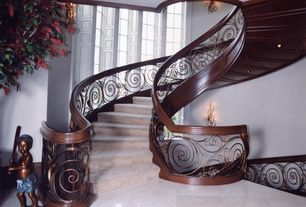 Traditional Staircase with Wall sconce, Carpet, High ceiling, Spiral staircase, Columns, Art nouveau style staircase