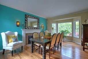 Eclectic Dining Room with Fireplace, picture window, Bay window, Hardwood floors, Standard height, double-hung window