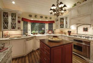 Country Kitchen with World Imports Lighting Sophisticated Iron 6 Light Chandelier, Raised panel, Complex marble counters