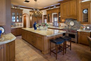 Country Kitchen with Chandelier, Complex granite counters, can lights, Custom hood, double oven range, Framed Partial Panel