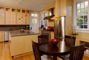 Modern Kitchen with European Cabinets, double oven range, Bamboo flooring, L-shaped, Transom window, can lights, Glass panel