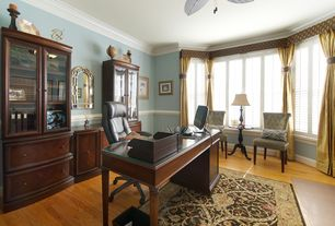 Traditional Home Office with Hardwood floors, Chair rail, Ceiling fan, Standard height, picture window, Crown molding