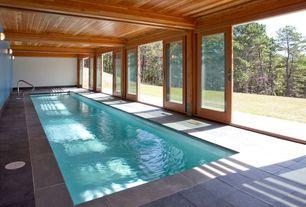 Craftsman Swimming Pool with exterior stone floors, Lap pool, Indoor pool