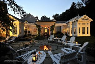 Traditional Patio with Simple white adirondack chair, French doors, exterior stone floors, Adirondack sidetable, Fire pit