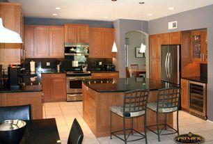 Craftsman Kitchen with limestone tile floors, Quartz counters, built-in microwave, Breakfast bar, Quartz, Flat panel cabinets