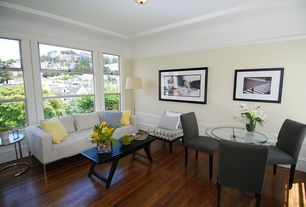 Contemporary Living Room with Paint 2, double-hung window, Wainscotting, Chintaly imports, Hardwood floors, Standard height