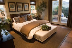 Contemporary Master Bedroom with sandstone tile floors, Standard height, French doors, stone tile floors, picture window