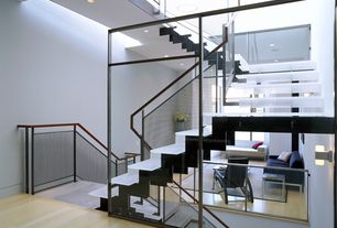 Contemporary Staircase with Laminate floors, Wall sconce, High ceiling, Glass staircase