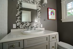 Modern Full Bathroom with Daltile Fashion Accents Black Pebble 12x12 Decorative Accent, Vessel sink, Wall sconce