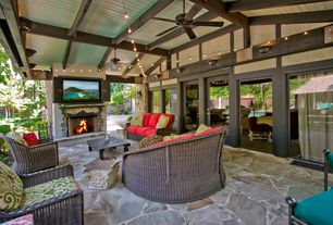 Craftsman Patio with French doors, exterior stone floors, Fence, Raised beds