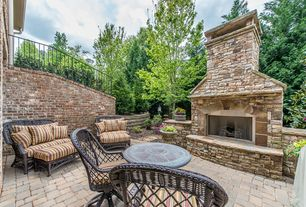 Traditional Patio with exterior brick floors, Raised beds