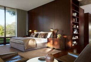 Contemporary Master Bedroom with Built-in bookshelf, Rug studio safavieh bohemian boh525f beige - multi area rug, 9 x 12