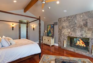 Eclectic Master Bedroom with Ceiling fan, Standard height, Exposed beam, Hardwood floors, can lights, Wall sconce, Fireplace