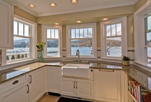 Traditional Kitchen with Farmhouse sink, Flat panel cabinets, Complex granite counters, U-shaped, Crown molding, Subway Tile