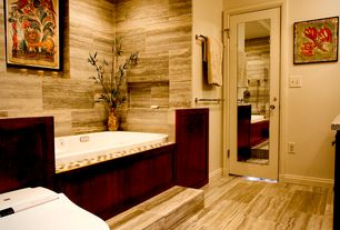 Contemporary Master Bathroom with Simple granite counters, Bathtub, Master bathroom, specialty door, stone tile floors