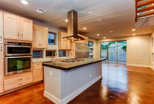 Contemporary Kitchen with Kitchen island, Standard height, slate floors, dishwasher, Flat panel cabinets, Soapstone counters