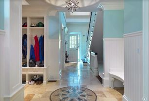 Country Mud Room with Built-in bookshelf, Pendant light, Crown molding, Standard height, Wainscotting, travertine floors