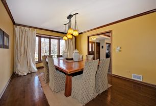 Craftsman Dining Room with Chandelier, Crown molding, Hardwood floors, Bay window