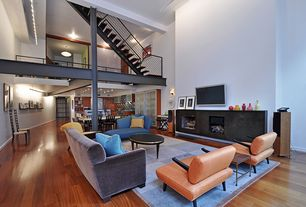 Contemporary Living Room with Cooper Blue Velvet Sofa, High ceiling, Columns, Hardwood floors, Loft