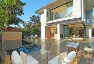 Contemporary Patio with exterior terracotta tile floors, picture window, Fence, sliding glass door, exterior tile floors