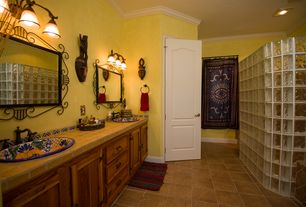 Eclectic Master Bathroom with Standard height, no showerdoor, Flat panel cabinets, Limestone tile counters, Crown molding