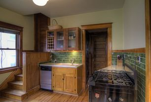 Craftsman Kitchen with Flat panel cabinets, Limestone counters, specialty door, L-shaped, Inset cabinets, Subway Tile
