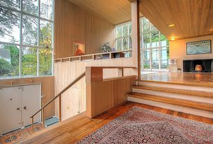 Contemporary Staircase with Standard height, Columns, Hardwood floors, Floating staircase