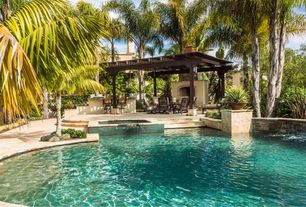 Mediterranean Swimming Pool with Pathway, exterior stone floors, Outdoor kitchen, Pool with hot tub, Trellis, Fence