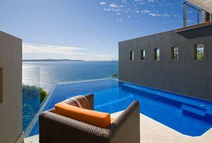 Mediterranean Swimming Pool with Infinity pool, exterior stone floors