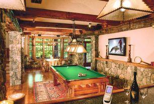 Rustic Game Room with flush light, Columns, Pendant light, Exposed beam, Hardwood floors, French doors
