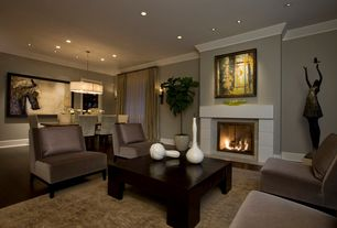 Contemporary Living Room with Hardwood floors, Chandelier with shade, Layered window treatments, Cement fireplace