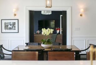 Contemporary Dining Room with specialty door, High ceiling, Wall sconce, Pendant light, Wainscotting